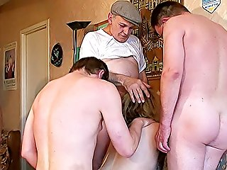 It's an interracial home gangbang party and cutie in stockings gets her hairy pussy fucked by five older dudes