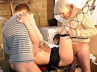 Kinky grandpa watches younger chick strip naked in a laundry room and fucks her ass to mouth together with her bf