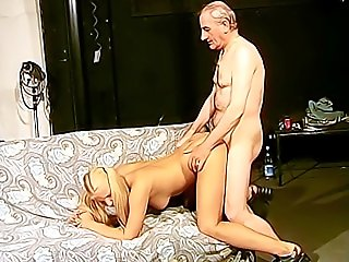 Blonde model with cute ponytails gets her pussy licked good and drilled from behind by a kinky old TV producer