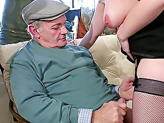 Naughty redhead in stockings swallows old cock and gets banged mouth to pussy by a couple of older depraved men