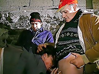 Three European bums pick up a younger slut while searching the trash cans and gangbang her in their secret hideout
