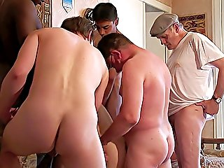 Five older men team-up to get their cocks sucked good and gangbang cutie in black stockings like never before