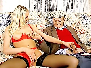 Hot blonde in black stockings and red lingerie set massaging her clit and jerking old grandpa's cock at the same time