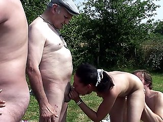 Three horny mature men and a kinky old grandpa gangbang a couple of naughty bisexual girlfriends outdoors