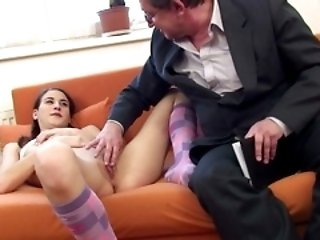 Wrinkly old bloke sticks his big fat cock into a young innocent schoolgirl's fresh lips.