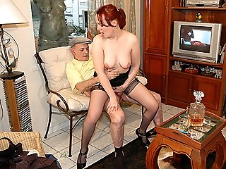 Sex-crazed red-haired slut in black stockings and garterbelt getting licked and fucked by two older perverted men