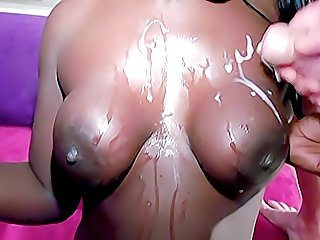 Hot ebony chick getting double-teamed by a couple of old white perverts and taking messy cumshots on her lovely tits