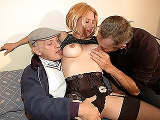 20 y.o. beauty in sexy black stockings and garterbelt getting fucked mouth to pussy by two horny old studs