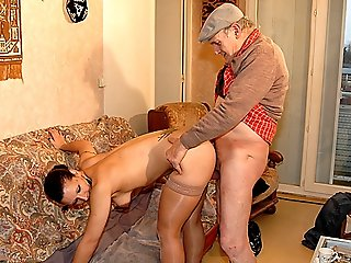Cute chick in sexy hold-up stockings and high-heel shoes getting gangbanged by old and perverted black and white men